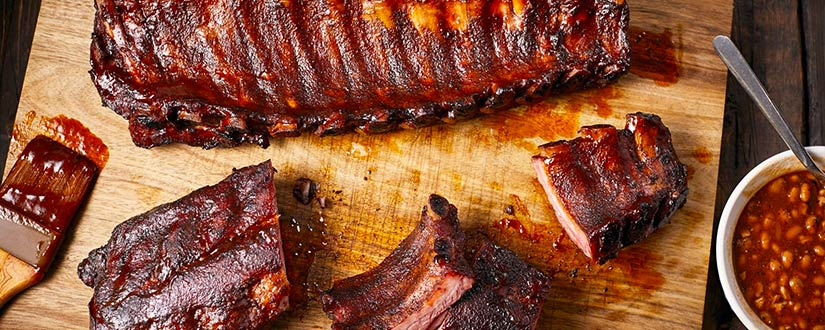 How to reheat ribs so that they retain their tenderness, juiciness, and flavor?